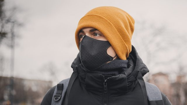 Man in winter hat and face mask
