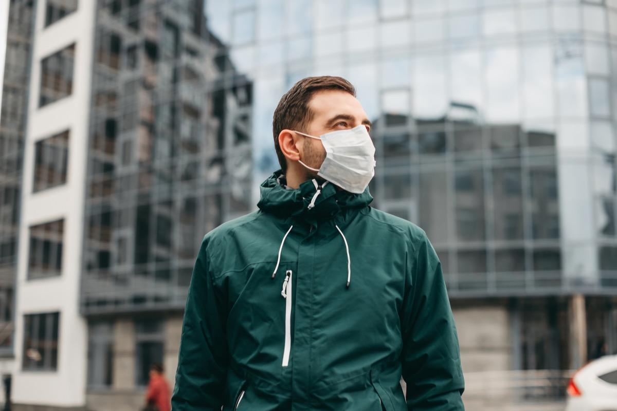 Man wearing mask in city