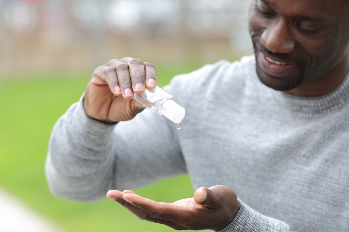 Man pouring hand sanitizer