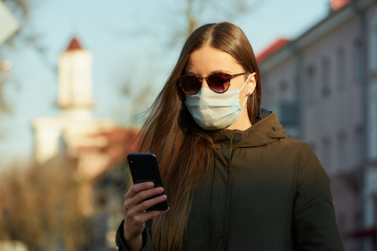 Woman in sunglasses and mask