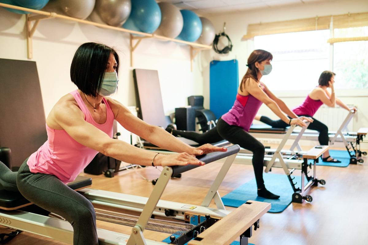Women doing pilates in masks