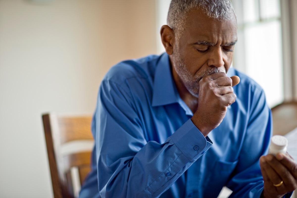 Man coughing from coronavirus