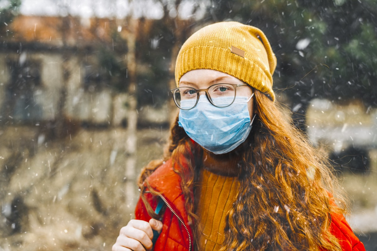 Teenage girl wearing protective mask for school during medical crisis of epidemic virus spreading covid 19