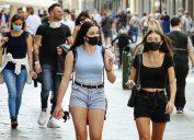 Crowd of people wearing masks outside