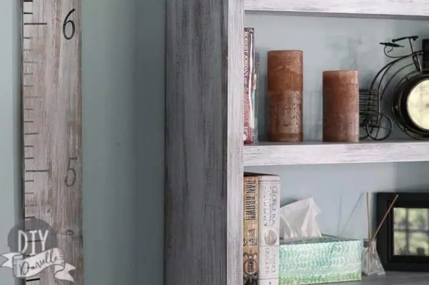 gray bookshelf with candles and books