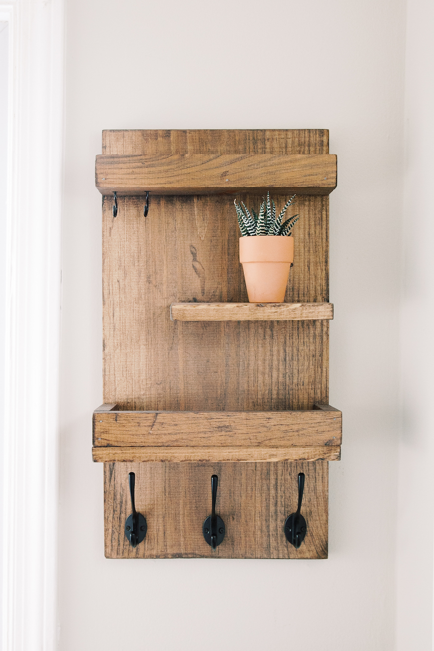 wooden entryway organizer with succulent