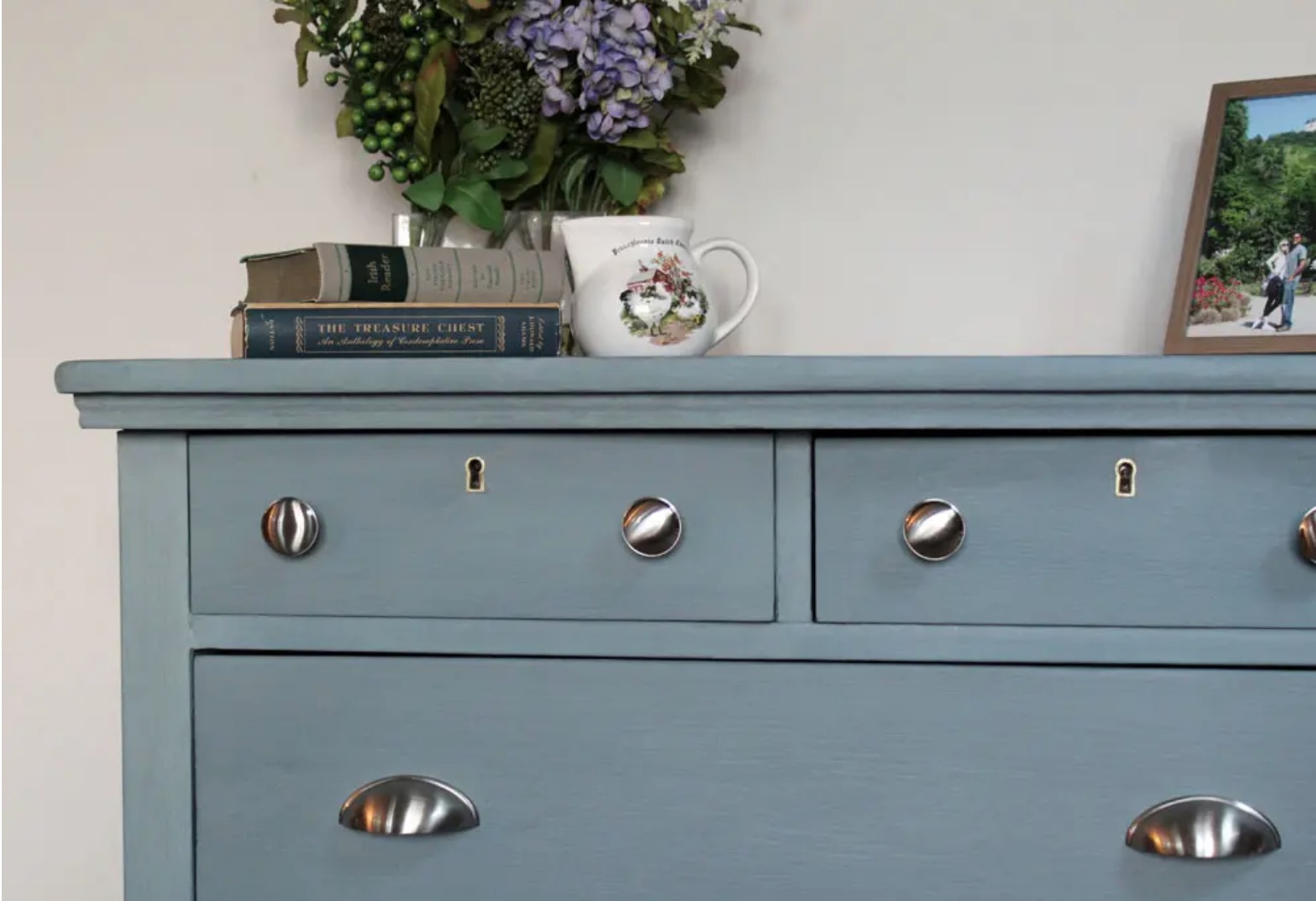 blue dresser with silver drawer pulls