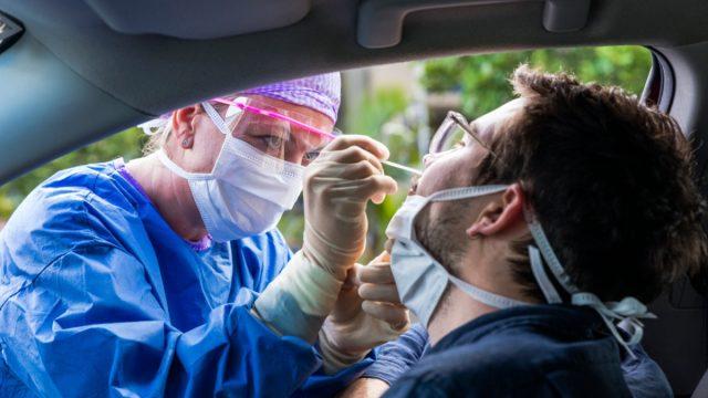 man getting drive through coronavirus test