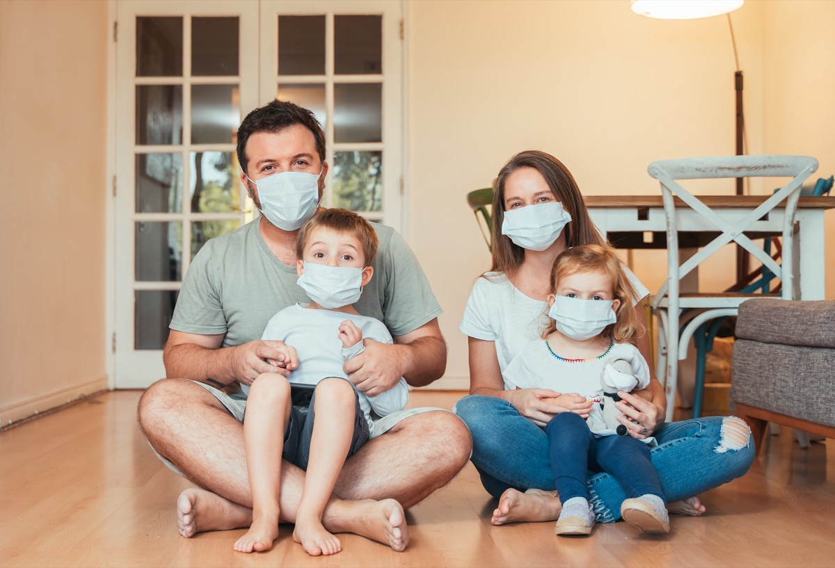 a family wears face masks at home