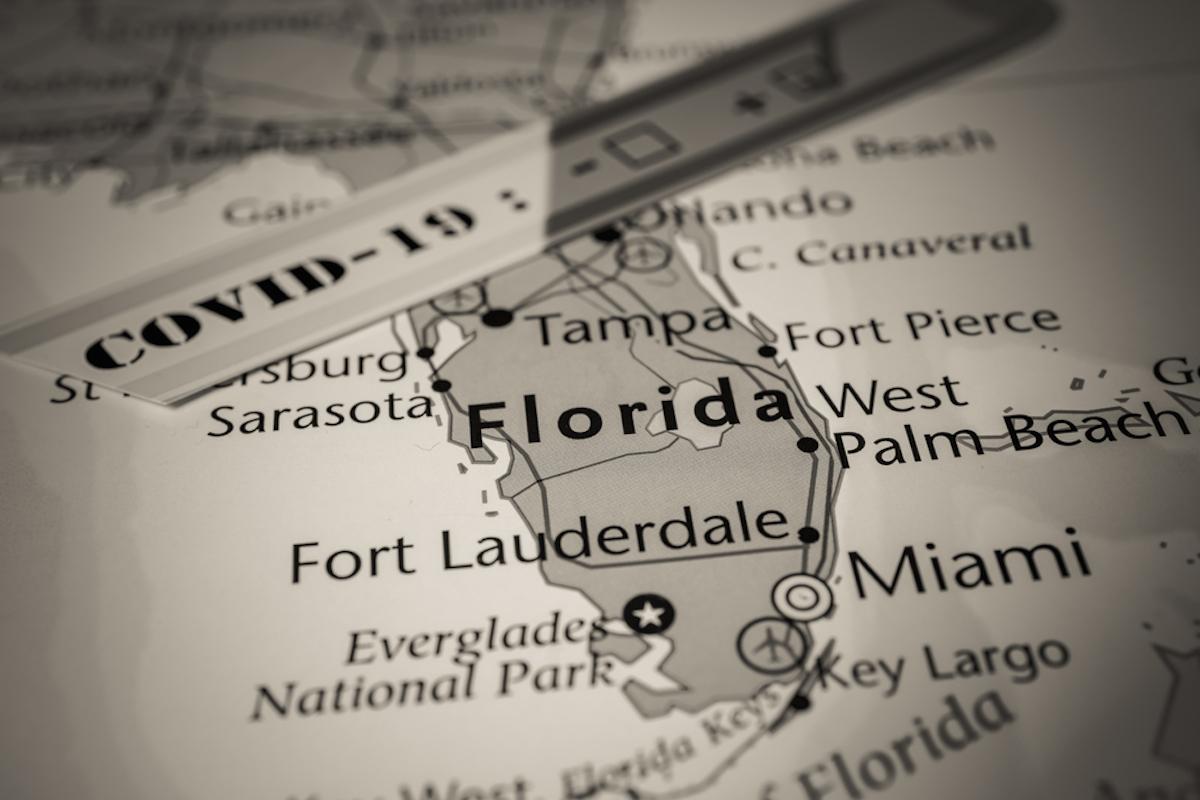 map of florida with coronavirus stamp on it
