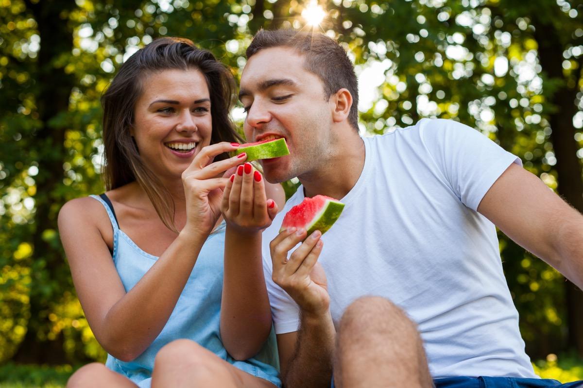 Man eating watermelon fruit