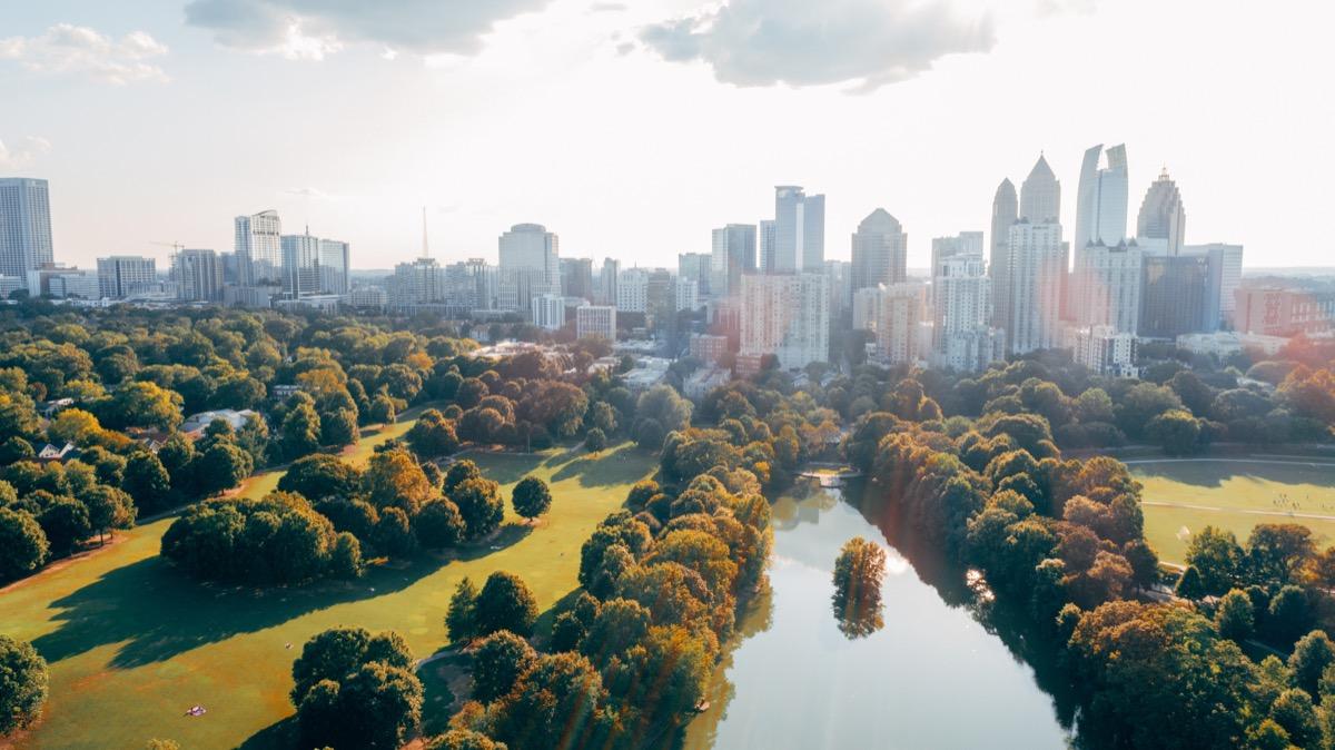 Aerial over Piedmont Park with Atlanta, GA Skyline