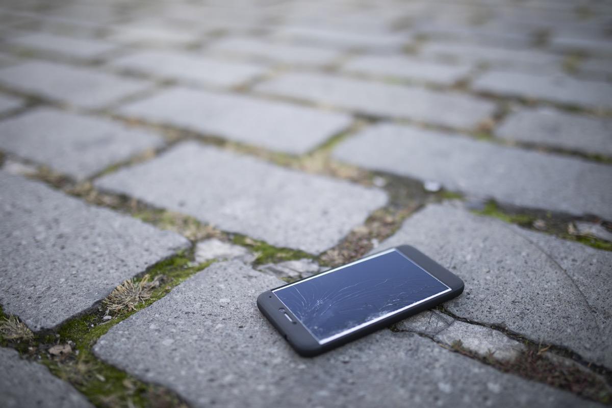 broken iphone on ground
