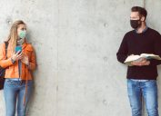 Man and woman social distancing with masks