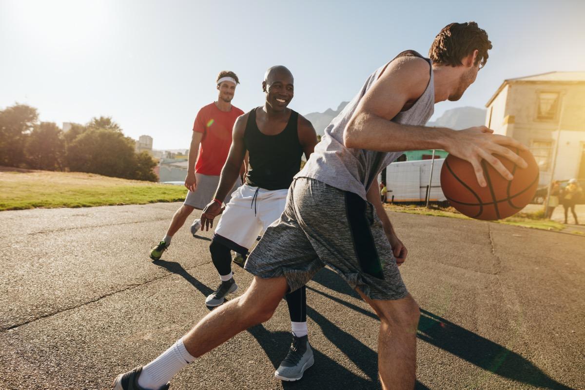 men playing basketball outside