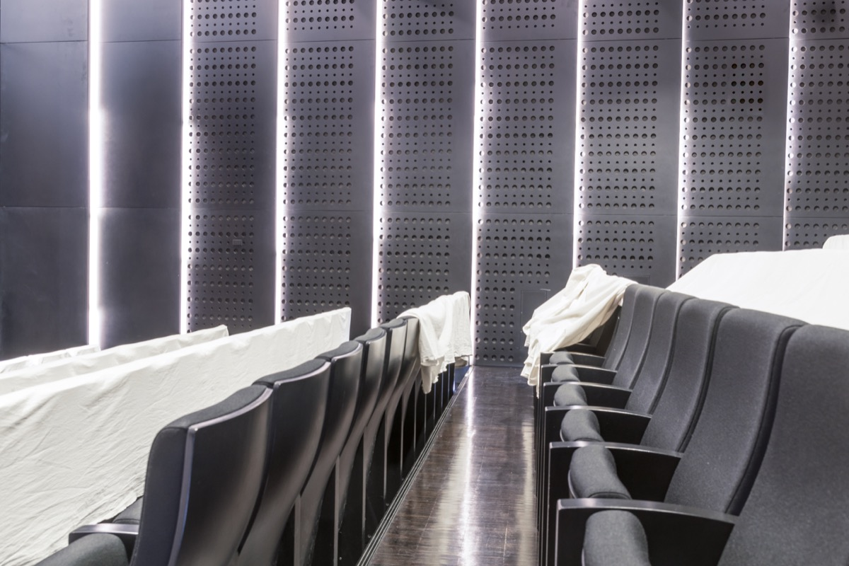 Empty Movie Theater with covered seats