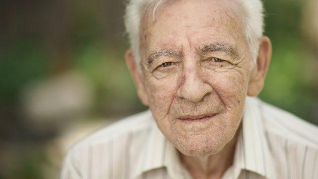 older white man looking at camera