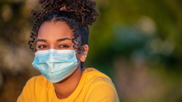 teenage girl wearing a face mask