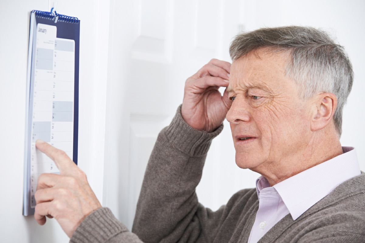confused older white man pointing at calendar