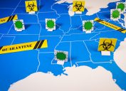 Map of united states with coronavirus and quarantine signs