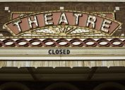 a vintage theater marquee with a closed sign