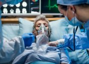 white woman receiving oxygen with coronavirus or flu in hospital