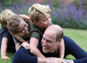 prince william plays in grass with prince george, princess charlotte, and prince louis
