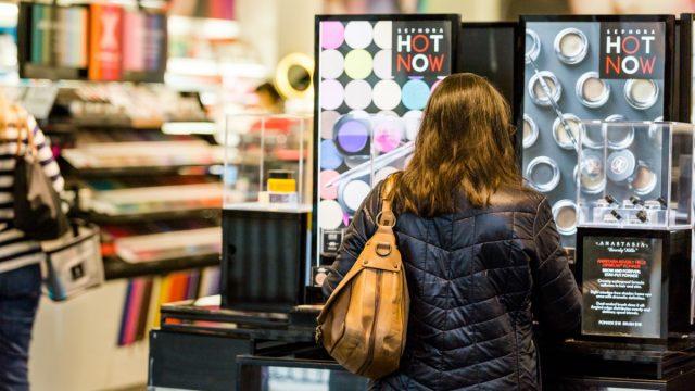 woman shopping makeup rack at sephora