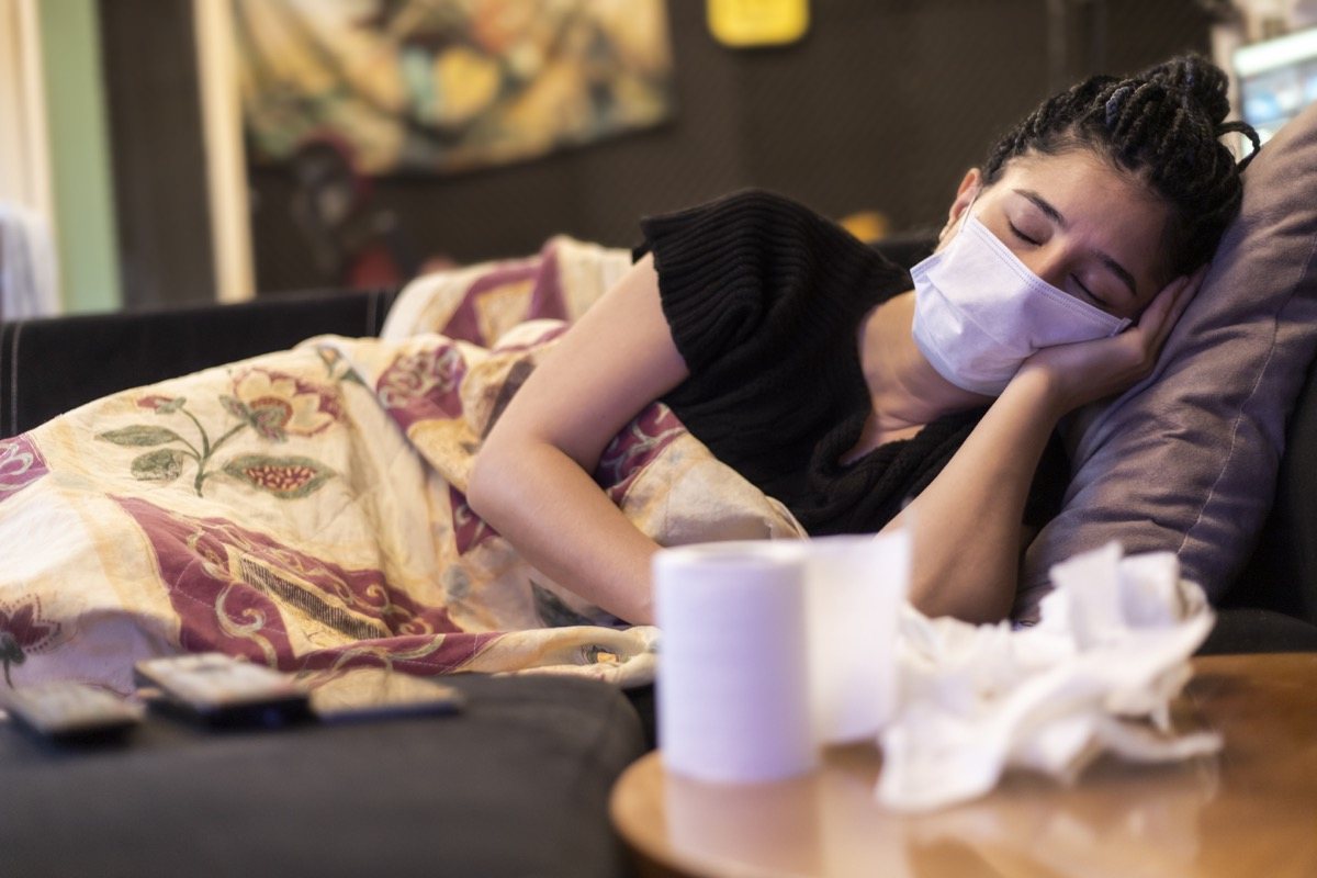 One woman infected with virus and sick. sleeping in home, using face mask, handkerchief and toilet paper on table