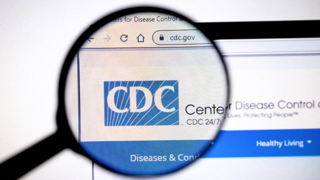 Magnifying glass viewing CDC webpage