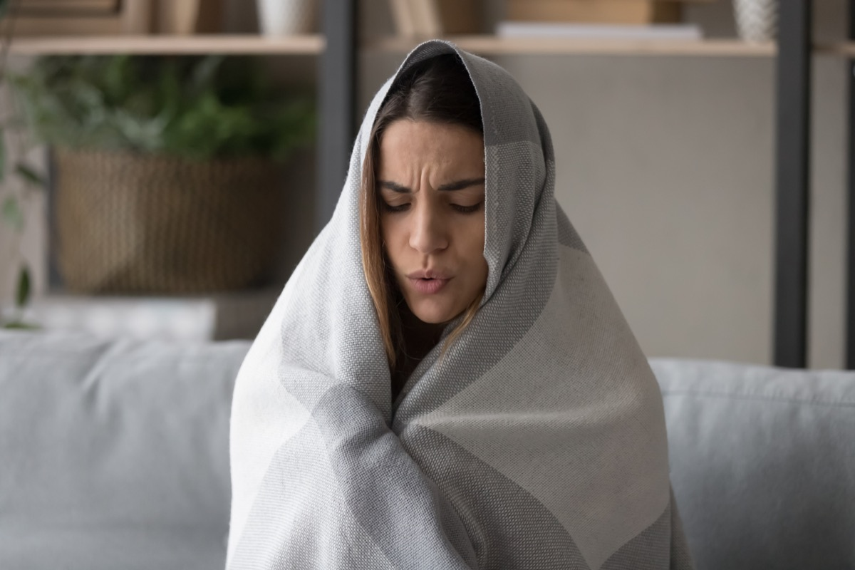 Sick woman wrapped in blanket