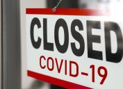 Closed COVID-19 sign on door