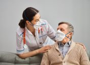 Elderly patient and doctor with masks