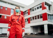 Female doctor standing in front of hospital