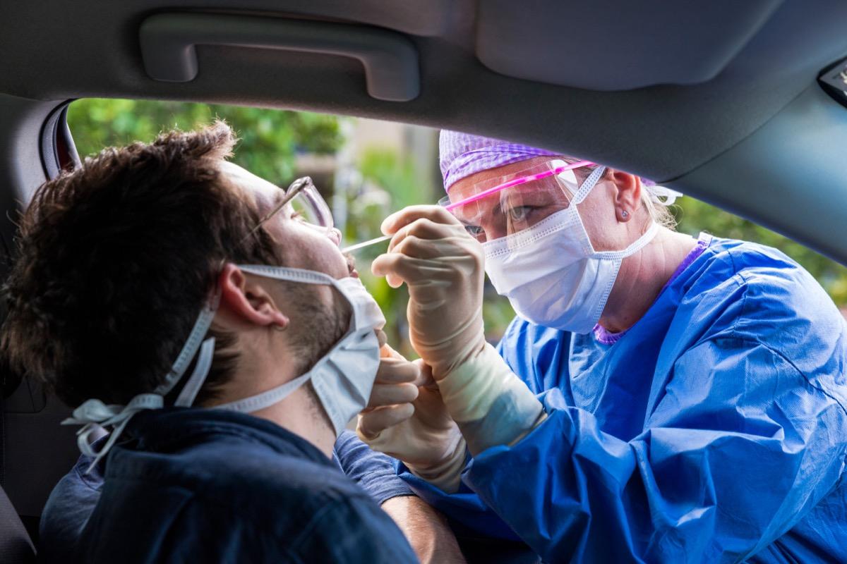Man getting coronavirus test from car
