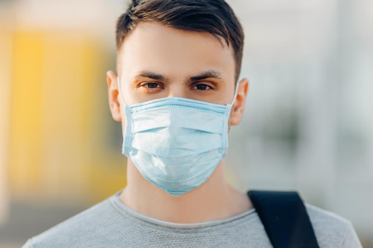 Man outside wearing medical mask
