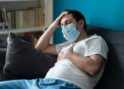 Sick man wearing mask