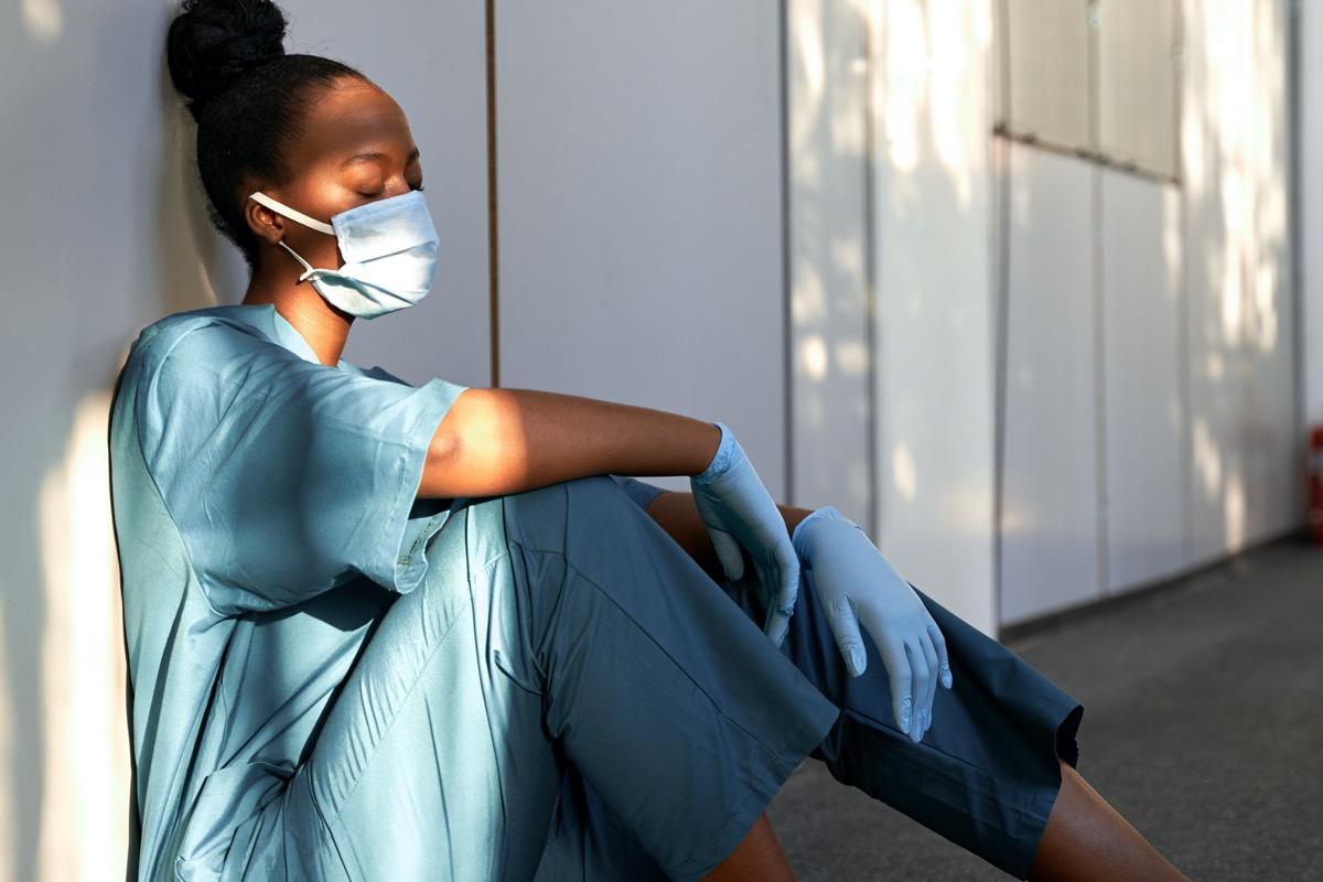Doctor/nurse sitting on floor
