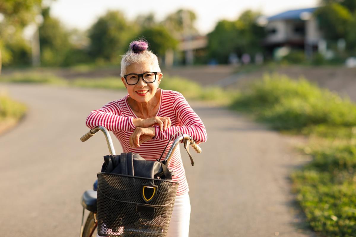 Asian senior woman on bike