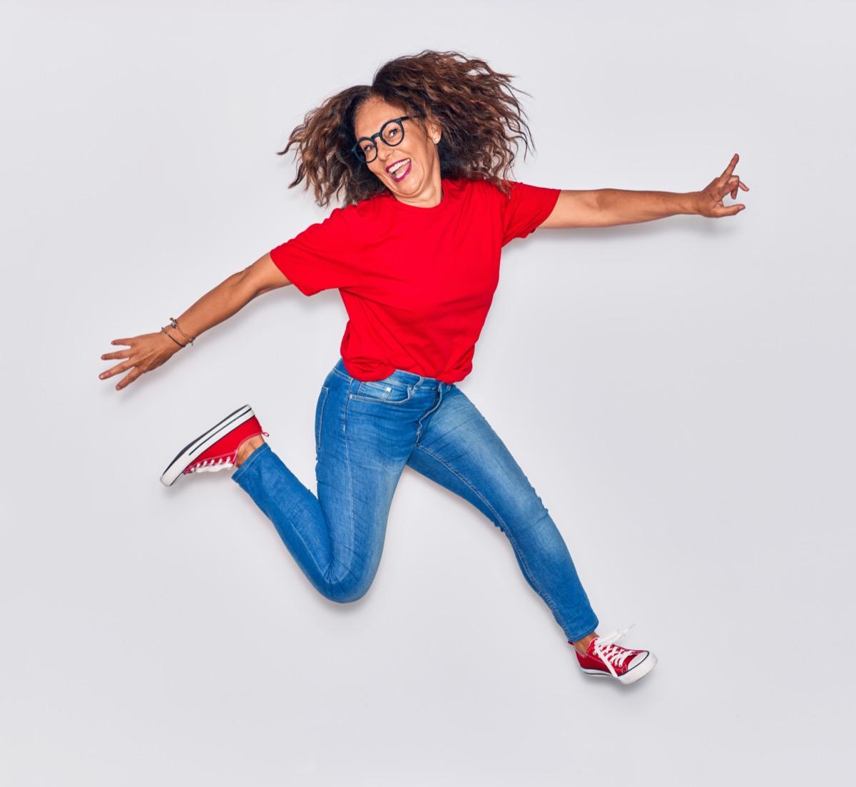 Senior woman jumping for joy