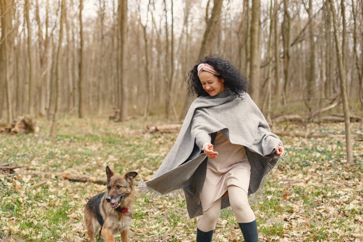 Woman in woods with dog