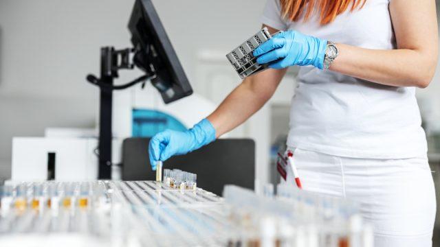 Woman processing coronavirus tests