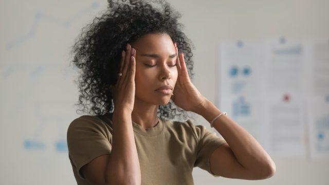 Young black woman having migraine