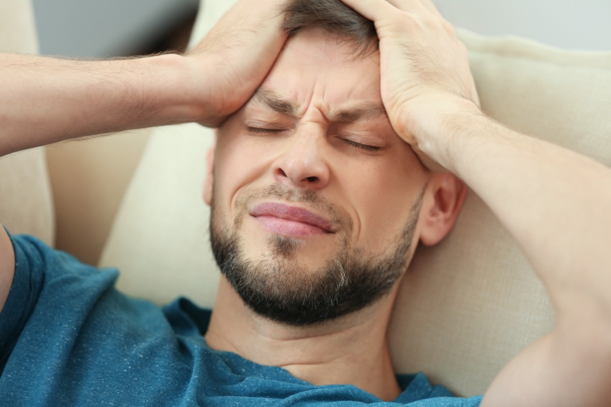 Young man having a migraine