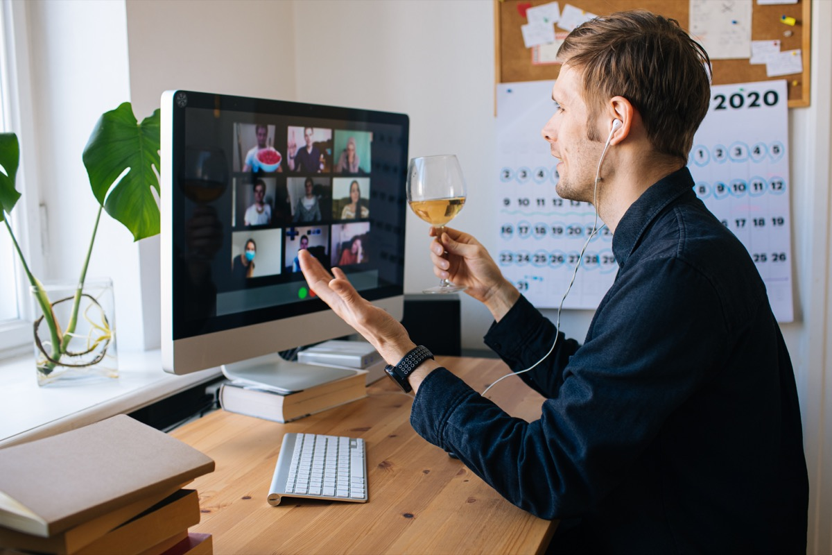 Man holding zoom happy hour with friends