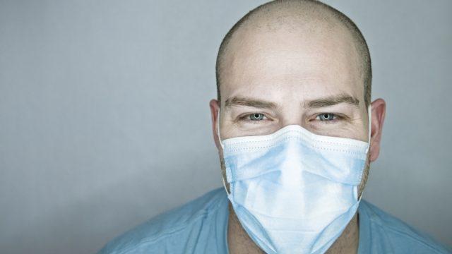 balding man wearing a mask