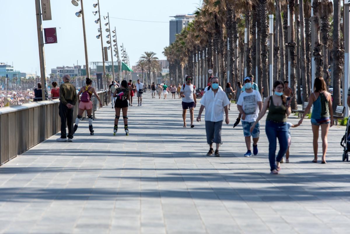 exterior shot of crowded barcelona boardwalk in june 2020