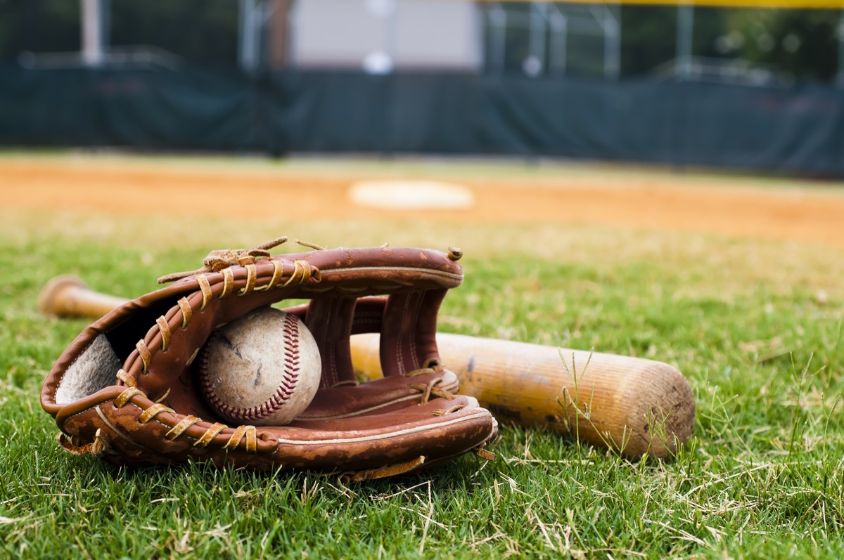 baseball bat and glove and ball on grass