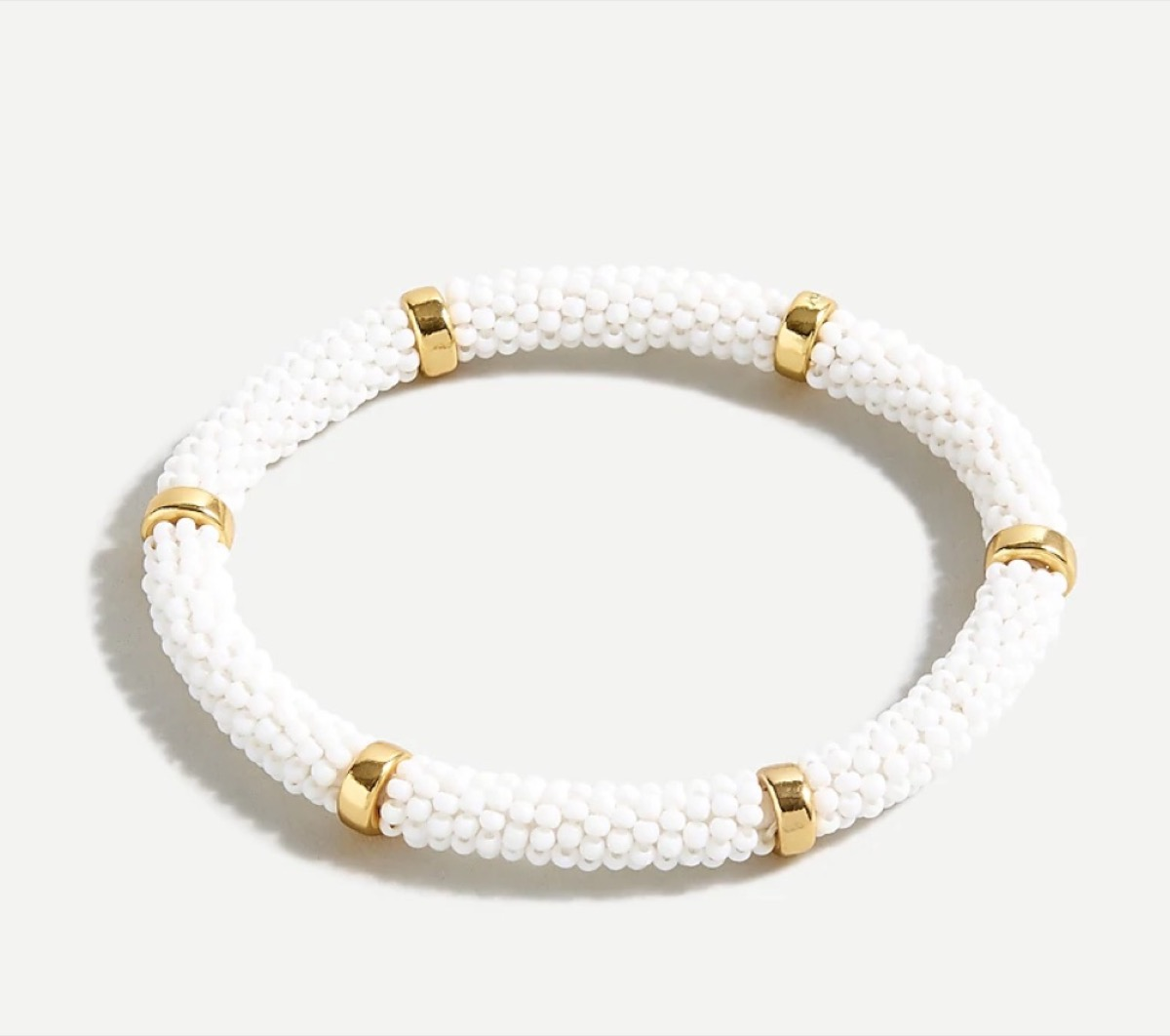 white beaded bangle with gold accents