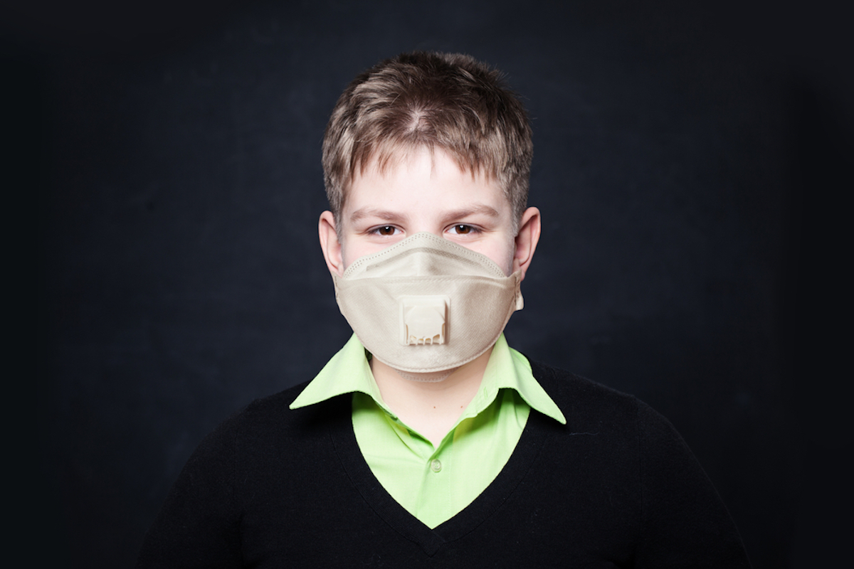 child wearing mask with respirator